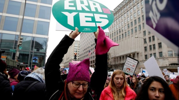 A demonstrator holds a sign calling for an equal rights amendment (ERA) during in the Third Annual Women's March at Freedom Plaza in Washington